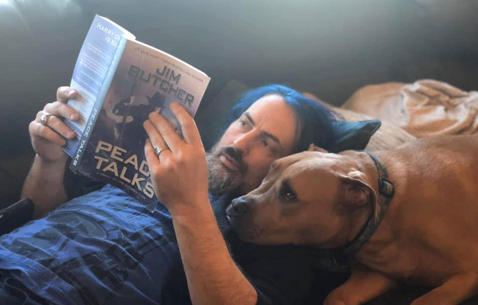 Jim reads Peace Talks to his very concerned pit bull, Bru