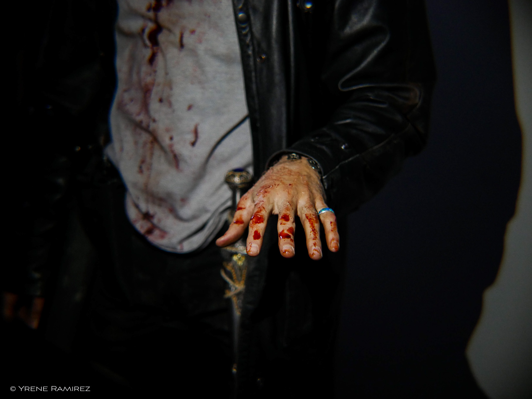Harry's bloodied shirt and hands. Whoops, that ring shouldn't be there!
